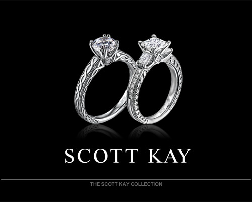 "For 25 years, Scott Kay has been acclaimed the foremost authority in bridal and fine fashion jewelry. Industry polls confirm Scott Kay is the number one best-selling bridal brand. Fellow celebrities often are adorned by Scott Kay's hand-perfected fine fashion platinum designs, offered in ""Art of Man"" hand-woven wristwear, neckwear, cuffwear, key fobs and more. You must see and feel a Scott Kay design for yourself to truly experience the precession and intricate features within each and every hand forged selection. Scott Kay's vast popularity is due in part to an intense pas..."